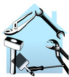 Hand tool and house Royalty Free Stock Images