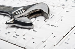 Hand tool on keyboard Royalty Free Stock Images