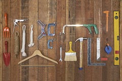 Hand tools and equipments hang on wood board Royalty Free Stock Image