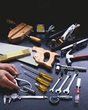 Hand Tools with Hands and Copy Space at Top Stock Image
