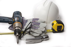 Hand tools hardhat hammer. Safety gear hand tools hammer leather gloves measuring tape goggles drill Royalty Free Stock Images