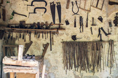 Hand tools. Room with pile of vintage hand tools Royalty Free Stock Photo