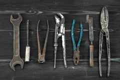 Hand Tools set flat lay. Used vintage retro style. On wooden desk royalty free stock image