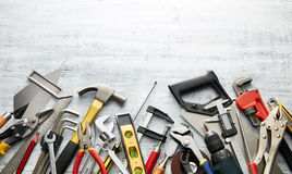 Hand tools. Variety of tools on white textured background with copy space Stock Photos