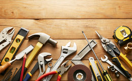 Hand tools. Variety of tools on wood planks with copy space stock image