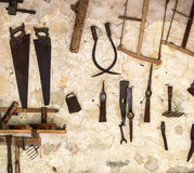 Hand tools. Wall with pile of vintage hand tools royalty free stock image