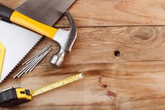 Hand tools on wood. Assortment of tools on wood Royalty Free Stock Photography