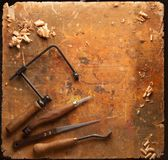 Hand tools Wood on an old wooden workbench. Hand tools Wood Drill Jig Saw plane chisel on an old wooden workbench royalty free stock photo