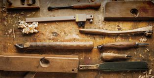 Hand tools Wood on an old wooden workbench. Hand tools Wood Drill Jig Saw plane chisel on an old wooden workbench royalty free stock image