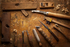 Hand tools Wood on an old wooden workbench Stock Image