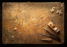 Hand tools Wood on an old wooden workbench Royalty Free Stock Photo