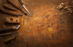 Hand tools Wood on an old wooden workbench Stock Photography