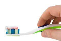 Hand with toothbrush Stock Photography