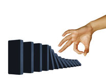 Hand toppling dominoes Stock Photography