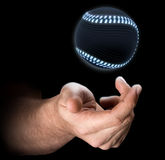 Hand Tossing Baseball. A male hand tossing a futuristic baseball up in the air on an isolated dark background - 3D render Stock Photo