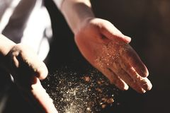 Hand tossing flour Royalty Free Stock Images