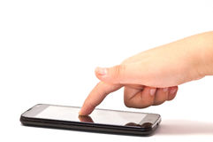 Hand Touch on Black Smart phone Stock Photos