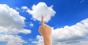 Hand touch blue sky and white cloud Stock Image