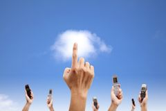 Hand touch the cloud and holding mobile phone. Cloud computing and smart phone concept Royalty Free Stock Image