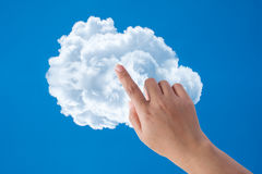 Hand touch the cloud Stock Photography