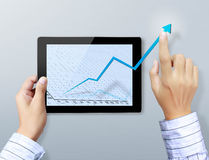 Hand touch graph on the tablet Stock Images