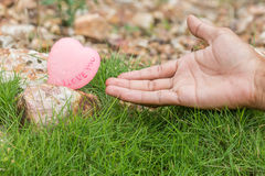 Hand touch heart love on rock Royalty Free Stock Images