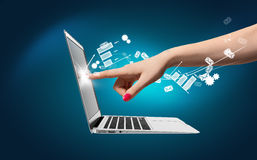Hand touch laptop, icons around Royalty Free Stock Image