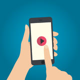Hand touch play button on smartphone vector. EPS 10 Royalty Free Stock Image