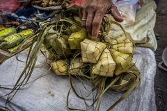 A hand touch rice wraped with coconut leaf with diamond shape in traditional market Bogor Indonesia Royalty Free Stock Image