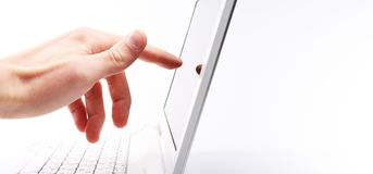 The hand touch the screen Royalty Free Stock Photography