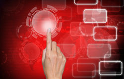 Hand touch screen on red icons background Royalty Free Stock Photos
