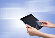 Hand touch screen on tablet pc. Female hand touch screen on tablet pc. with icons over blue-violet background Royalty Free Stock Photos