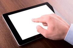 Hand on a touch screen of tablet pc Stock Images