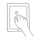 Hand touch screen on tablet Royalty Free Stock Photography