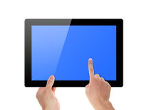 Hand touch screen on tablet pc Royalty Free Stock Image