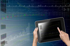 Hand touch screen to Tablet Stock Photo