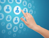 Hand Touch Social Media Icon. Woman hands touch social media icon on futuristic screen Royalty Free Stock Photo