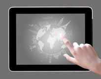 Hand touch on tablet pc to drawing travel Stock Image