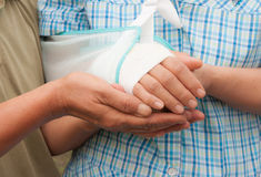 Hand touches. And holds an wrinkled hand Royalty Free Stock Image