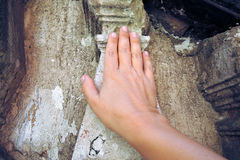 Hand touches ancient walls Stock Images