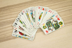 Hand touches deck of cards Royalty Free Stock Photos