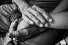 Hand touches and holds an old man wrinkled Royalty Free Stock Photo