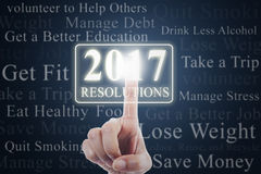 Hand touches resolutions with numbers 2017. Image of hand pressing a virtual button with numbers 2017 and new year resolutions Royalty Free Stock Photo