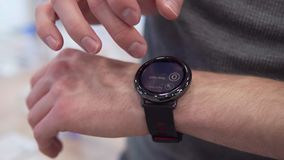 Hand touches smart watch stock footage