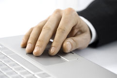 Hand touches track pad stock photo