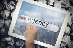 Hand touching agency on search bar on tablet screen Stock Photography