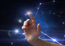 Hand touching the air with glow Stock Photo