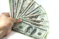 Hand touching all stack type of american dollars Royalty Free Stock Image