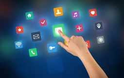 Hand touching apps. Female hand touching colorful applications Royalty Free Stock Photos