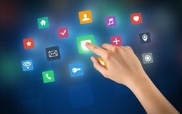 Hand touching apps. Female hand touching colorful applications Royalty Free Stock Images